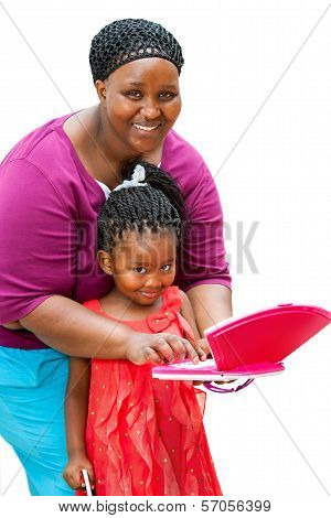 African Mother Helping Child On Laptop.