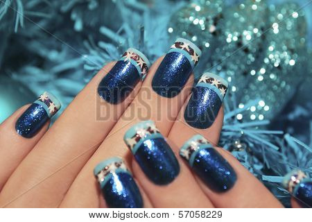 Beautiful winter blue manicure .