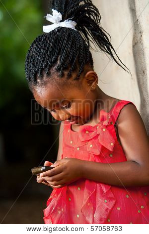 Pigtailed African Girl Playing With Smart Phone.