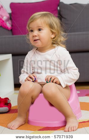 Little Girl Sitting On The Potty
