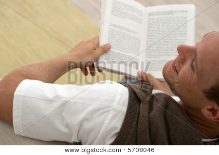 Man Reading A Good Book