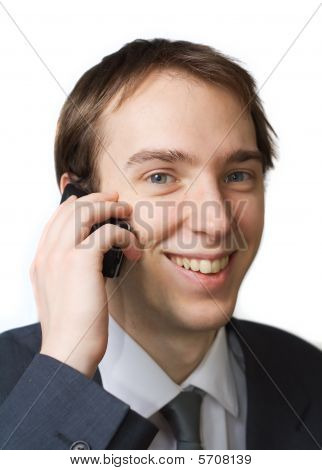 Young Professional Smiles While On The Phone