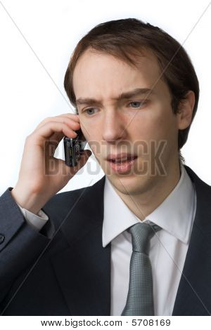 Young Professional Cringes On The Phone