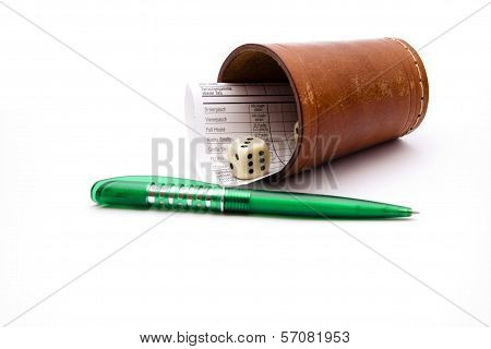 Dice Cup with Paper and Ball Point Pen on white background