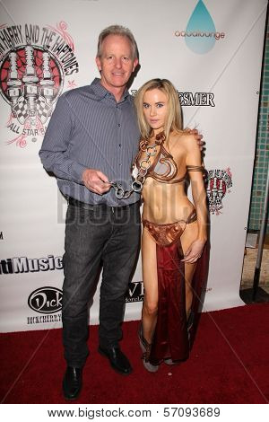 John Wiseman and Paula Labaredas at the Vera Mesmer Video Release Party, featuring Harry The Dog and Paula Labareas of ComicCosplay, Aqua Lounge, Beverly Hills, CA. 03-09-11