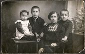 BIELSKO, POLAND, CIRCA 1910 -vintage photo of mother with two sons and a daughter