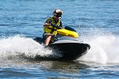picture of ski boat  - Man riding jet ski wet bike personal watercraft - JPG