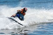 pic of ski boat  - Man on wave runner  - JPG