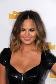 LOS ANGELES - JAN 14:  Chrissy Teigen at the 50th Anniversary Of Sports Illustrated Swimsuit Issue a