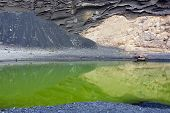 pic of geologie  - One of the many geologial marvels of Lanzarote is El Golfo an emerald green lagoon situated at the base of a spectacular crater on the west coast of the island - JPG
