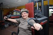 image of senior class  - Active senior woman exercising at the gym - JPG