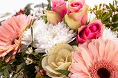 stock photo of tribute  - Bouquet of fresh pink and white flowers with a gerbera daisy dahlia and roses in a close up view as a background for celebrating Mothers Day a birthday anniversary Valentines or a special occasion - JPG