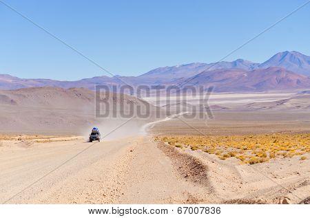 Bolivia, Antiplano - landscape with SUV