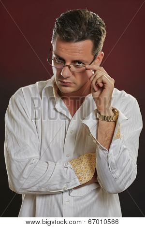 Suspicius Man Looking Over Eyeglasses