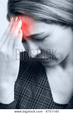 Tired Woman With Headache Or Migraine