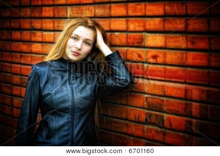 Sexy Stylish Woman In Leather Near Wall