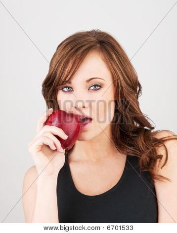 Beautiful Girl Biting Into A Red Apple