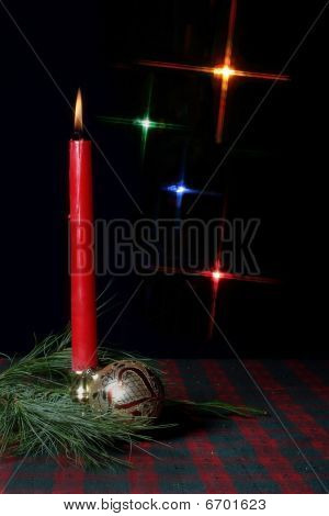 Candle and Ornament on holiday tablecloth