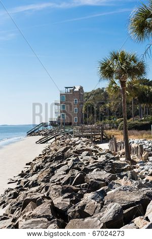 Rock Seawall Toward Piers And Beach Houses