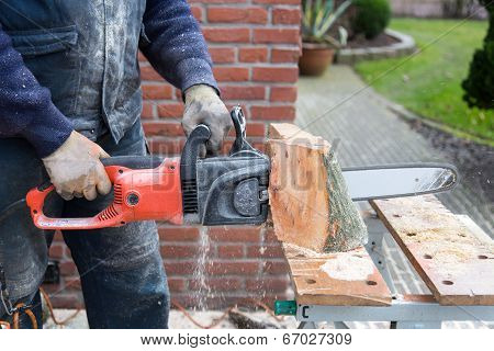 Chain saw cutting wood