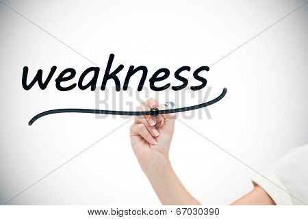 Businesswoman writing the word weaknesses against white background with vignette