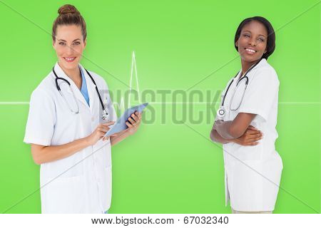 Composite image of smiling female medical team against medical background with green ecg line