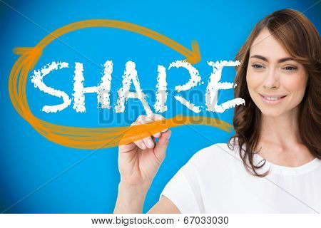 Businesswoman writing the word share against blue background with vignette