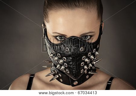 portrait of a woman in a mask with spikes