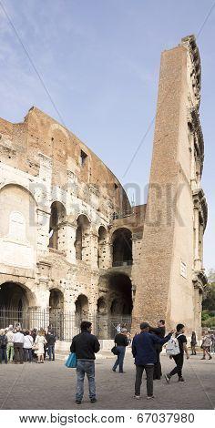 Tourists Visiting The Coliseum