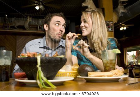 Cute Couple Eating Chips