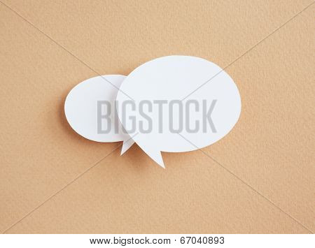 paper speech bubbles on brown background
