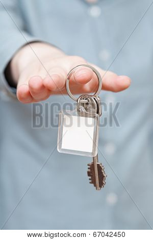 Blank Key Ring In Hand Close Up