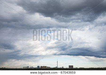 Dark Grey Rain Clouds Over City In Summer