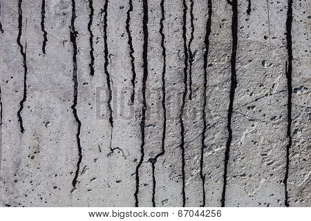 Grey Concrete Surface With Black Bitumen Streaks