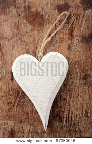 white wooden heart on old wooden background backdrop