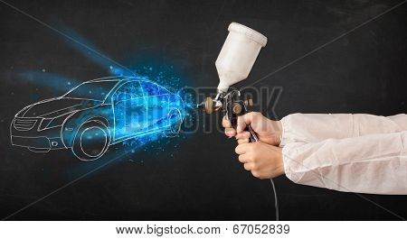 Worker with airbrush gun painting hand drawn white car lines