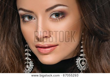 Model face, lips make-up, ear ring
