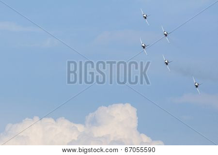 BERLIN, GERMANY - MAY 20, 2014: Aerobatic team Northrop F-5E Tiger II (Patrouille Swiss) demonstration during the International Aerospace Exhibition ILA Berlin Air Show-2014.