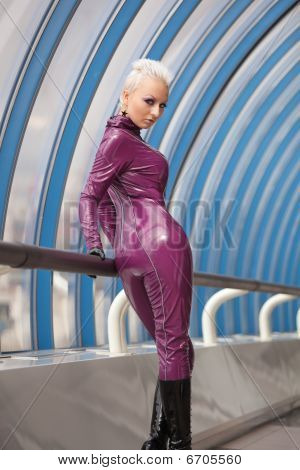 Girl In Fetish Suit. Modern style.