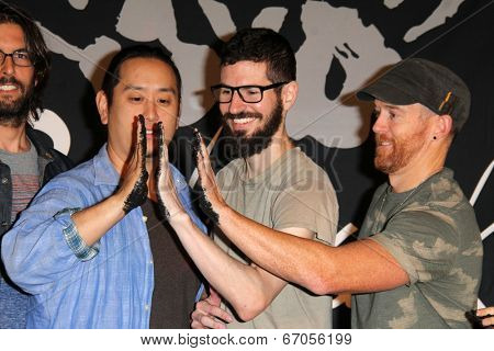 LOS ANGELES - JUN 18:  Joe Hahn, Brad Delson, Dave Farrell at the Linkin Park Rockwalk Inducting Ceremony at the Guitar Center on June 18, 2014 in Los Angeles, CA