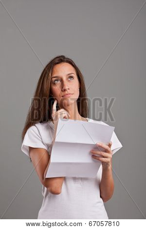 Girl Thinking About News On A Letter