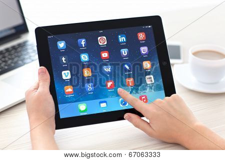 Female Hands Holding Ipad With Social Media App On The Screen In The Office