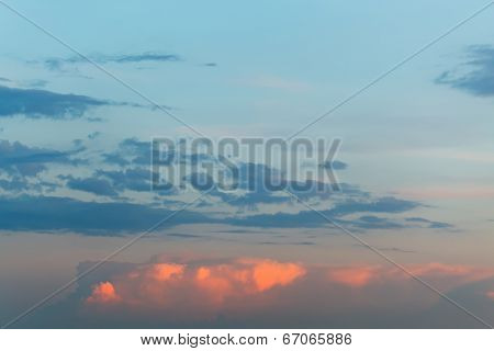 Pink Puffy Clouds In Blue Sunset Sky