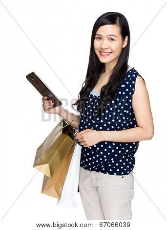 Woman hold with shopping bag and tablet