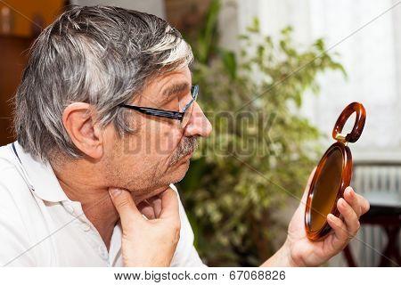 Senior Man With Mirror