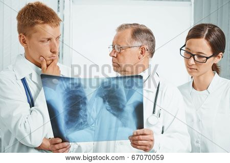 Doctors Examine X-ray Image In Hospital