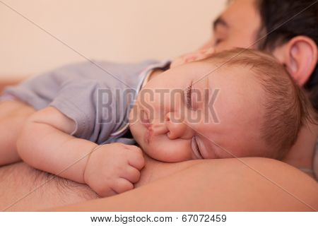 Baby sleeps on dad
