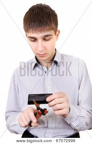 Teenager Cutting A Credit Card