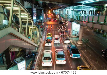 Bangkok, Thailand - May 22, 2014: Night Scenery With Heavy Traffic Near A Skytrain Station In Bangko