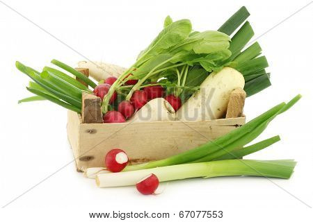 mixed vegetables in a wooden crate on a white background